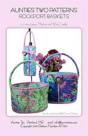 "Whole cloth channel stitched baskets in 3 sizes. Use fabric with lines in the print for easier channel stitching. Wine Caddy makes a wonderful table decoration or hostess gift! Large: 9"" tall x 12"" wide x 9"" deep; Medium: 6"" tall x 9"" wide x 7"" deep. Wine Caddy: 9"" tall x 4"" wide."